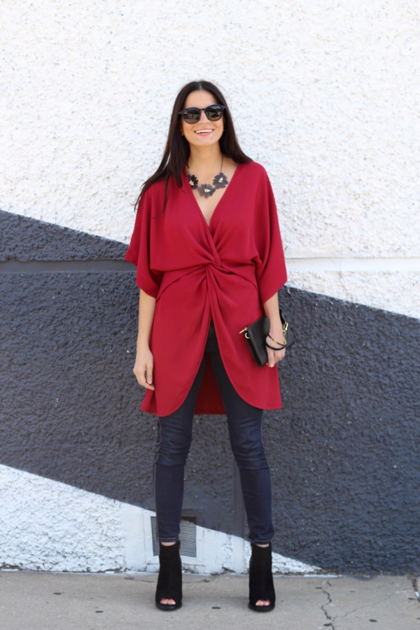 smiling in a red wrap dress