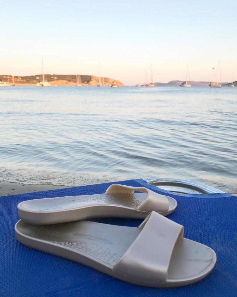 gold soak sandals at the beach
