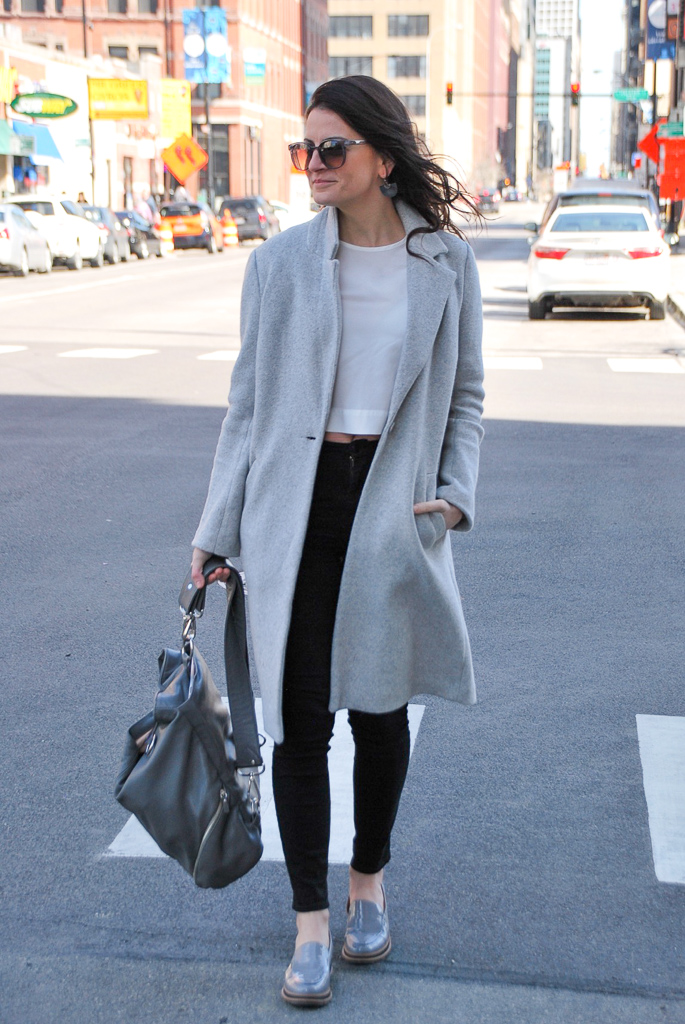 Gray long coat, gray leather backpack and gray patent leather loafers