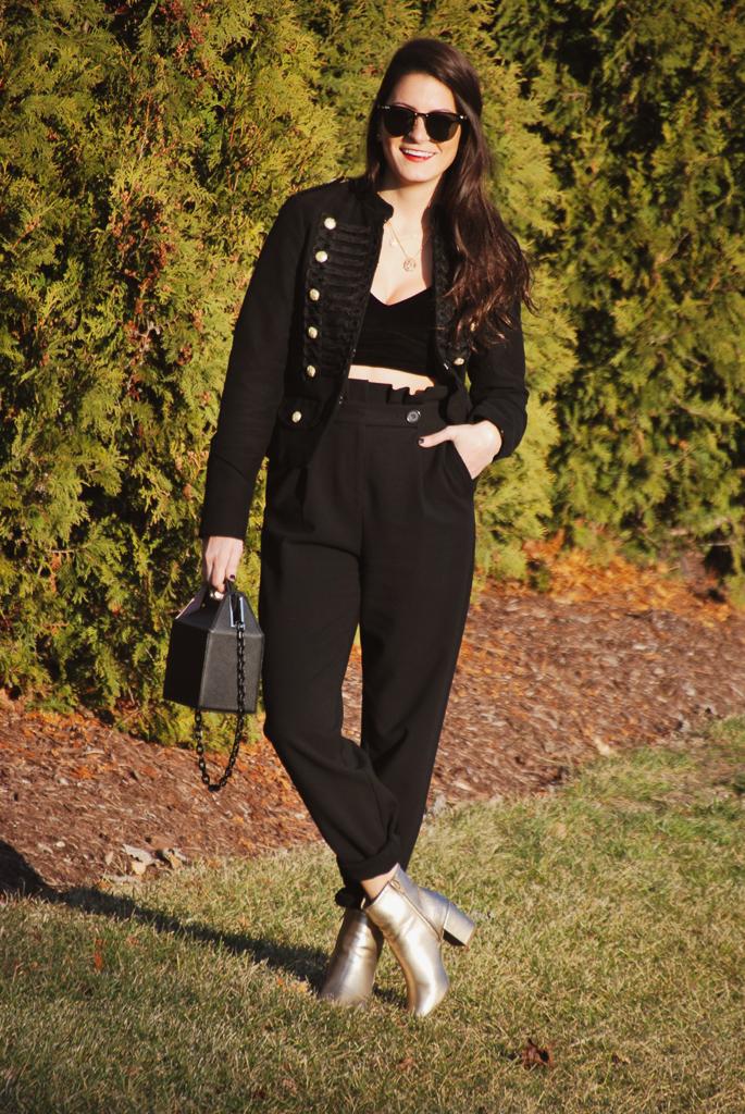 black velvet bralette, black trousers and black jacket