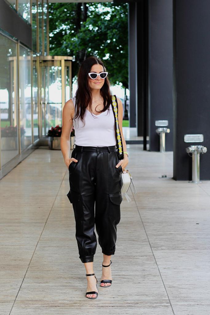 white bodysuit and black pleather cargo pants