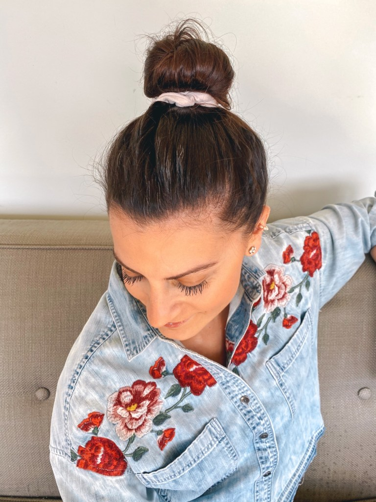 long dark lashes and messy top knot