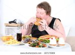 stock-photo-fat-man-eating-a-lot-of-unhealthy-food-on-home-interior-background-187173989