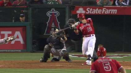 Johnny Giavotella lines a single to the opposite field, driving in Albert Pujols and