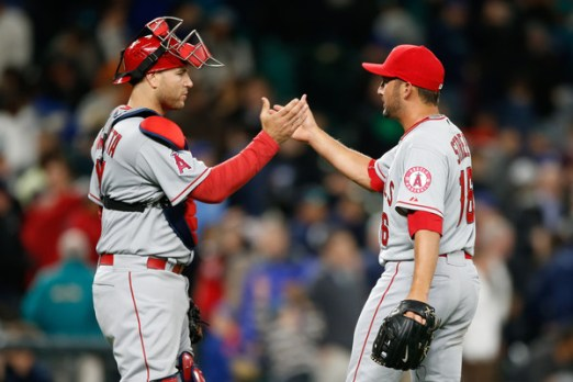 Huston Street (R) is congratulated by catcher Chris Iannetta (L)  after defeating the Seattle Mariners 5-3 in a game at Safeco Field on April 8, 2015 (Otto Greule, Jr./Getty Images)