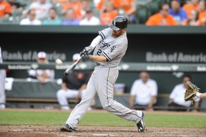 Adam LaRoche hits a two-run home run in the third inning of a game against the Baltimore Orioles at Camden Yards on May 28, 2015 (Mitchell Layton/Getty Images)
