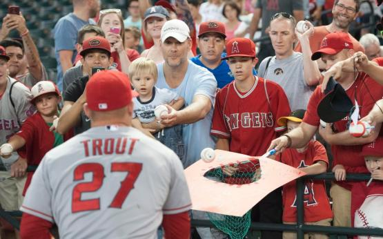 Angel fans look for autographs from Mike Trout before the Halos' game at Chase Field in Phoenix Wednesday. ///ADDITIONAL INFO:    angels.0618.kjs  ---  Photo by KEVIN SULLIVAN / Orange County Register  --  6/17/15 The Los Angeles Angels of Anaheim take on the Arizona Diamondbacks at Chase Field in Phoenix, Arizona Wednesday night.  6/17/15
