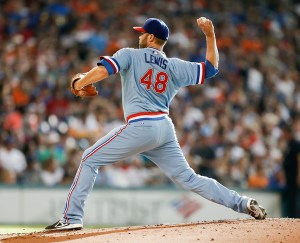 Colby Lewis, wearing a late 1970's era throwback uniform, delivers a pitch during the first inning of a game against the Houston Astros at Minute Maid Park on July 18, 2015 (Bob Levey/Getty Images)