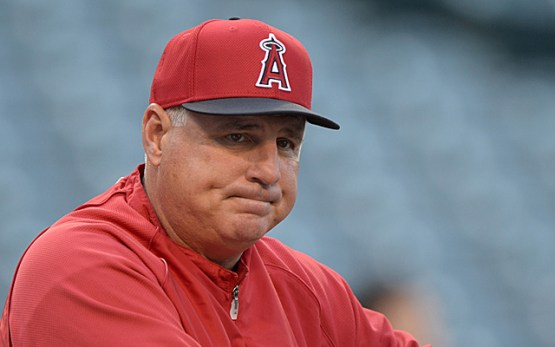 Apr 12, 2013; Anaheim, CA, USA; Los Angeles Angels manager Mike Scioscia (14) reacts before the game against the Houston Astros at Angel Stadium. Mandatory Credit: Kirby Lee-USA TODAY Sports
