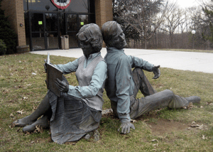Picture of our library statue, Symbiosis by J. Seward Johnson, Jr.