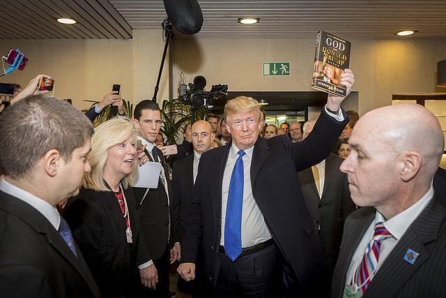 """President Trump lifts up Stephen Strang's book, """"God and Donald Trump"""" at Davos"""