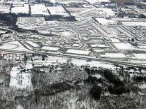 The Meadowlands Power Centre in Ancaster. A large forested area exists in the foreground. Other smaller forested areas of the time enhance the landscape.