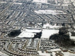 Crerar/Jerome neighborhoods. The forest on the right is currently being cut in half to make way for more town houses.