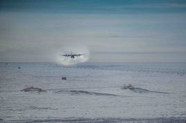 Contrails of the Herc landing on the skiway