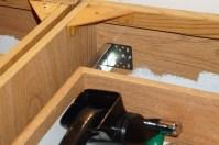 Bracket mounted to cabinet back
