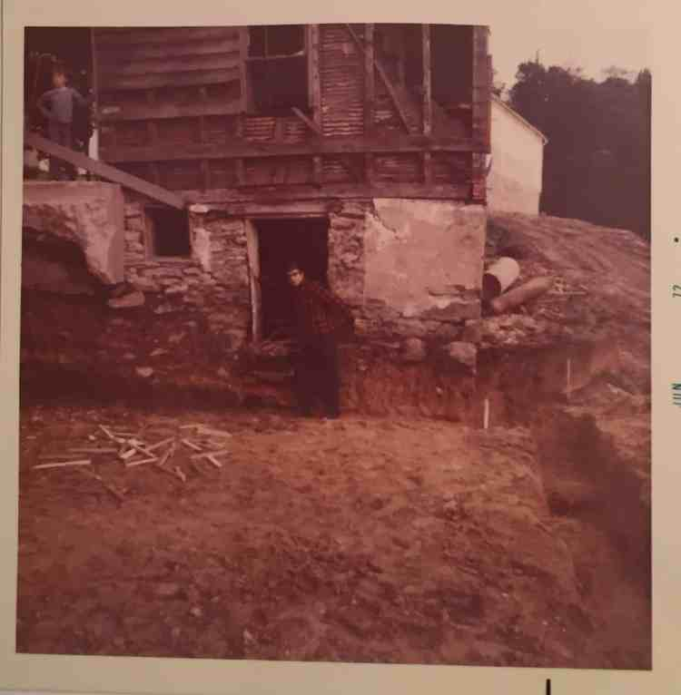 The door on the far right was an exterior entrance to the cellar of the original log house. Once the addition was put on you could still enter the cellar through the garage. It was the perfect place for all my grandmother's canned goods!