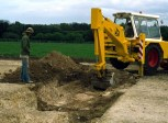 Ditch digging with machine.