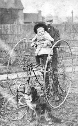 father and child with bicycle and dog