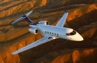Challenger 300 Aircraft Flying Over Mountains