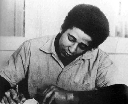 George-Jackson-writing-San-Quentin-web