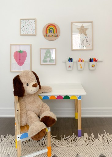 Gallery wall and craft corner with a kids rainbow room theme. The painted kids furniture looks so cute!