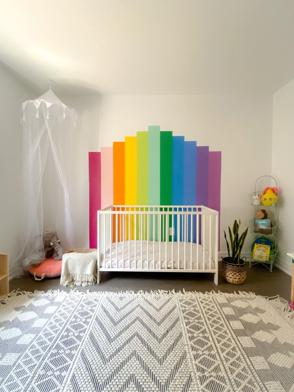 Rainbow wall mural in a nursery or girls room. Put a bed or crib in front of it. Hang a canopy in the corner for a kids reading nook