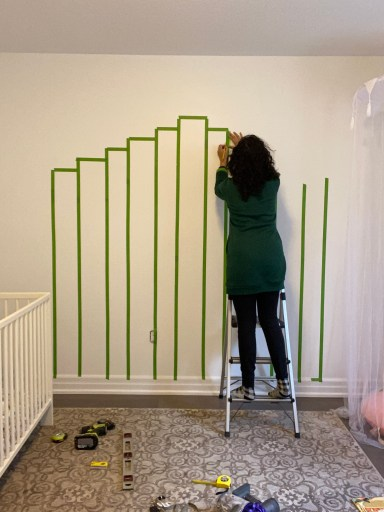 How to paint a rainbow mural, add the horizontal strips of painters tape