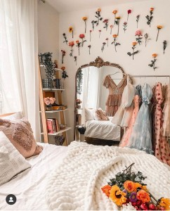 Bedroom with flowers on a wall