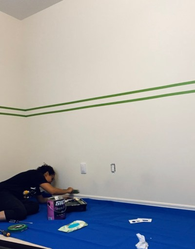 Tape off the wall before you start painting