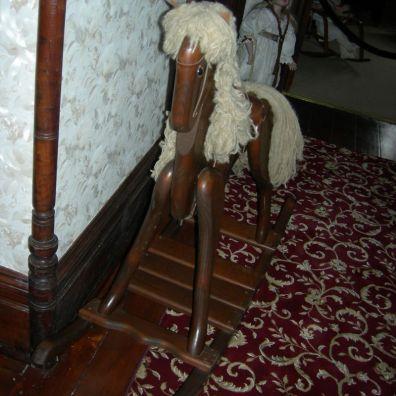 rocking horse, upstairs hallway