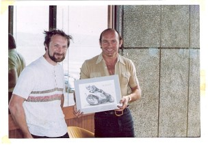 John presenting a set of four original drawings to Mike Hailwood at the 1978 TT races.