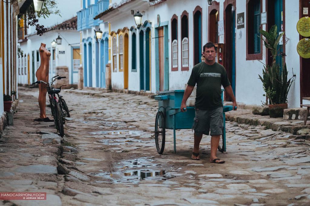man pulling cart paraty brazil
