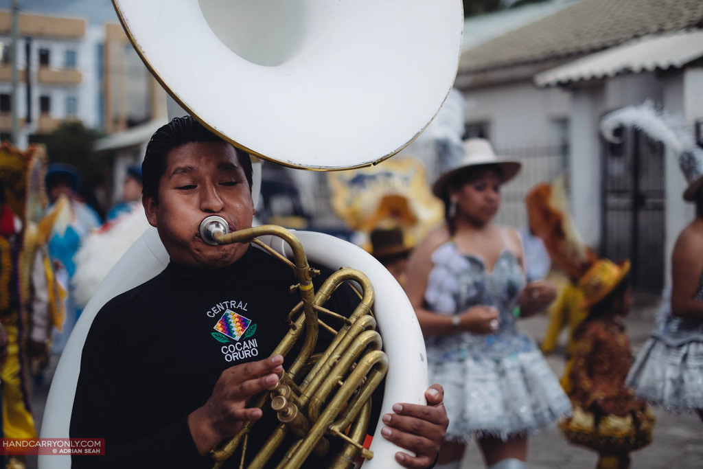 man on french horn playing his heart out, sucre, bolivia