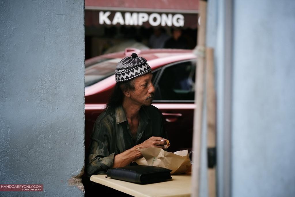 kampong man having lunch