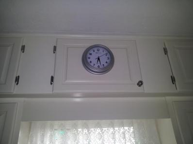 Clock mounted on middle door