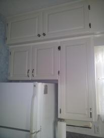 Refaced cabinetry and hinges