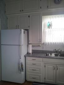 Refaced white cabinetry doors