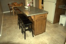 Island unit with built in garbage can. Functional islands can be designed for any size kitchen.