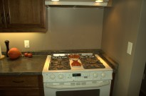 "Slide in gas range, allowing the countertop to be installed as one solid piece, note the countertop sliver (about 2"" W) at the back of the range."