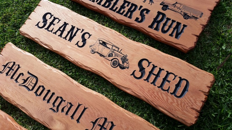 Picture of custom wooden signs engraved and painted then oiled