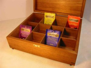 Photo of a Tea Box with the lid open. Tasmanian Blackwood. Brass catch. To suit Twinings tea sachets with dividers.