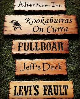 rustic timber signs scorched with flame