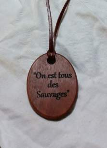 "handmade pendant necklace crafted from jarrah with fine kangaroo leather strap engraved with text ""On est tous des Sauvages"""