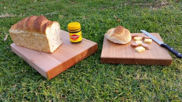 chopping boards on grass with bread cheese cabana and cutting knife