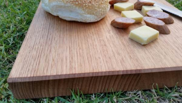 smaller cutting board with cheese knife and cabana