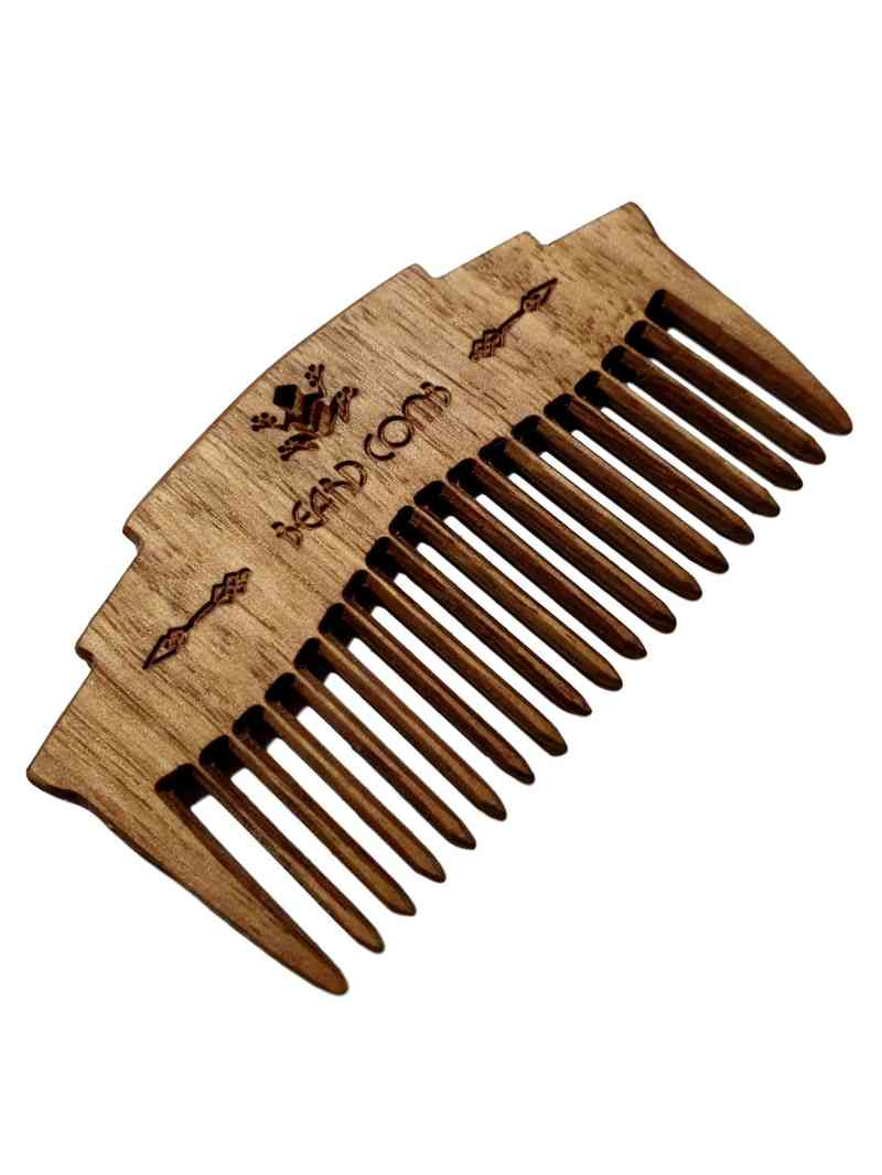 hand crafted wooden beard comb closeup image on white background