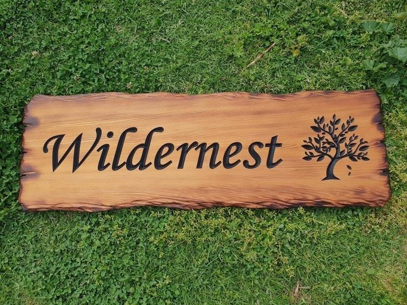 House name sign Wildernest made from Cedar scorched timber