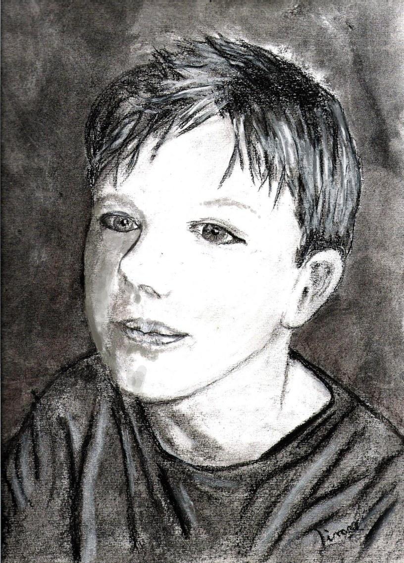 Dessin au fusain de mon fils Robin a 9 ans, on voit son visage en gros plan légèrement de profil.