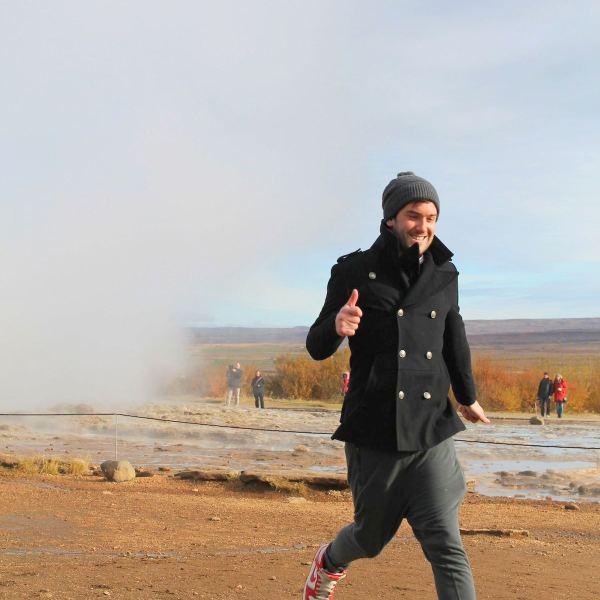 Lloyd Running Away From Geyser in Geysir, Iceland