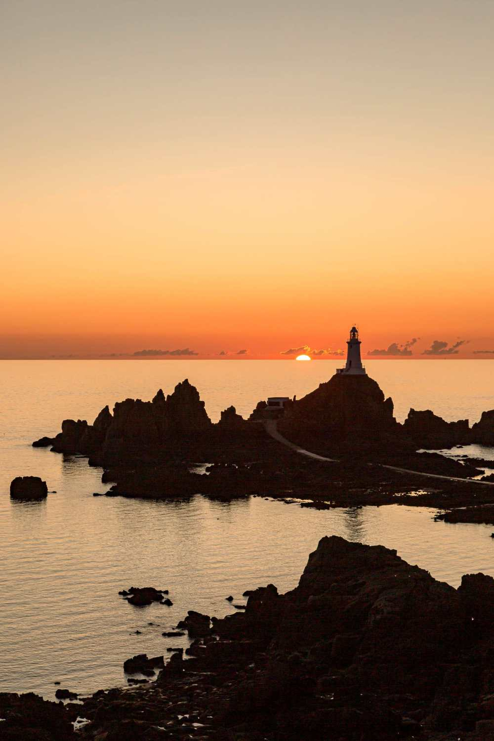 Sunset views over lighthouse In Jersey